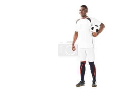 Photo for Full length view of smiling young african american soccer player holding ball and looking away isolated on white - Royalty Free Image