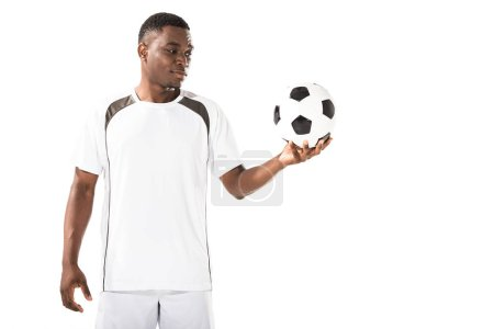 smiling african american soccer player holding ball isolated on white