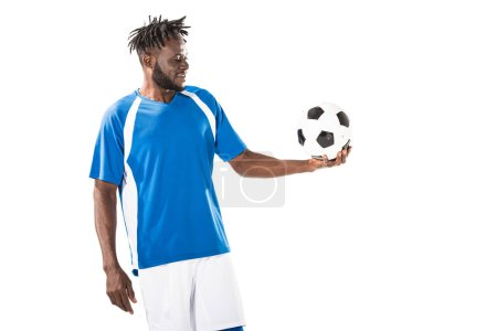 smiling african american sportsman holding soccer ball isolated on white