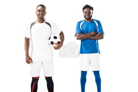 confident athletic young african american soccer players smiling at camera isolated on white