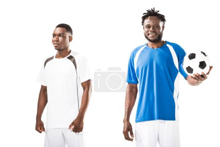 athletic young african american sportsmen standing with soccer ball isolated on white