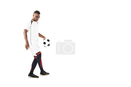 Photo for Handsome young african american sportsman playing with soccer ball isolated on white - Royalty Free Image