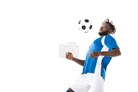 athletic young african american soccer player hitting ball with chest isolated on white
