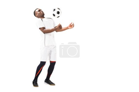 young african american soccer player hitting ball with chest isolated on white