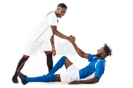 Photo for Happy young african american sportsman helping soccer player isolated on white - Royalty Free Image
