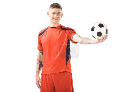 happy young sportsman holding soccer ball and smiling at camera isolated on white