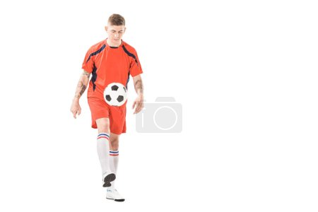 Photo for Athletic young sportsman in sportswear playing with soccer ball isolated on white - Royalty Free Image
