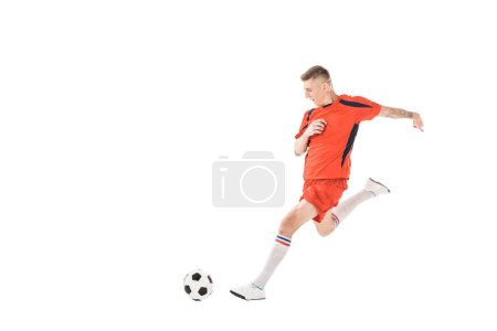 Photo for Full length view of young sportsman playing soccer isolated on white - Royalty Free Image