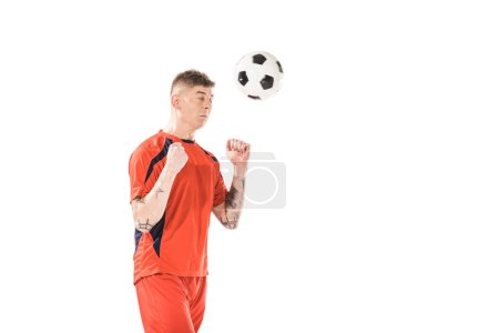 young soccer player hitting ball with head isolated on white