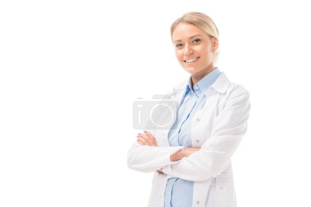 Photo for Happy young female doctor with crossed arms looking at camera isolated on white - Royalty Free Image