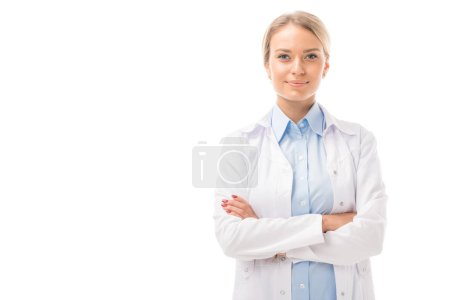 Photo for Confident young female doctor with crossed arms looking at camera isolated on white - Royalty Free Image
