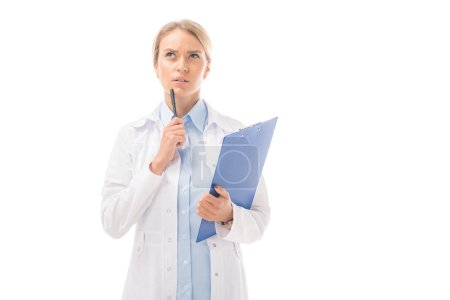Photo for Thoughtful young female doctor with clipboard looking up isolated on white - Royalty Free Image