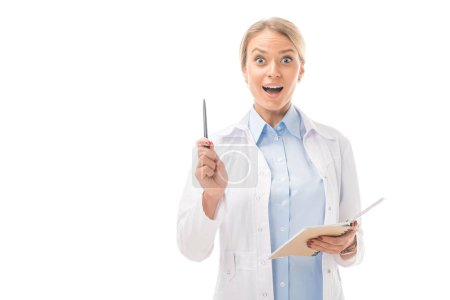expressive young female doctor with creative idea holding notebook and looking at camera isolated on white