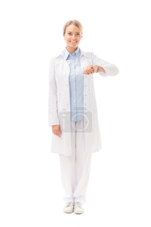 beautiful young female doctor with wrist watch looking at camera isolated on white