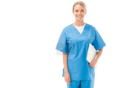 smiling young nurse with laptop looking at camera isolated on white