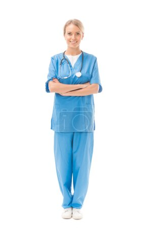 young nurse with crossed arms looking at camera isolated on white