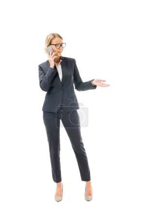 emotional young businesswoman talking by phone isolated on white