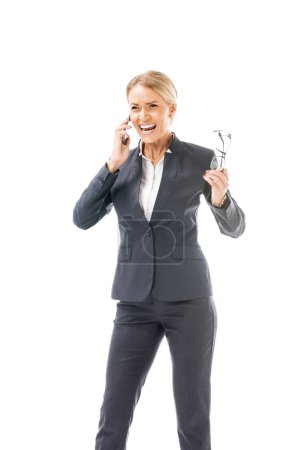 mad young businesswoman screaming during phone talk isolated on white