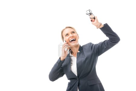 expressive young businesswoman talking by phone while shouting and looking up isolated on white