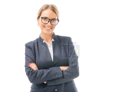 Photo for Smiling young businesswoman crossed arms looking at camera isolated on white - Royalty Free Image