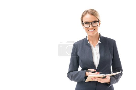 beautiful young businesswoman with notebook looking at camera isolated on white