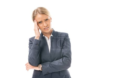 suffering young businesswoman with headache looking at camera isolated on white