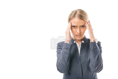suffering young businesswoman with headache holding head looking at camera isolated on white