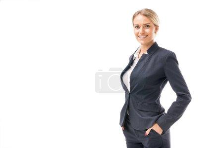 Photo pour Belle jeune femme d'affaires en costume regardant caméra isolé sur blanc - image libre de droit