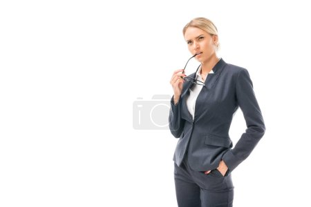 confident young businesswoman looking away with thoughtful expression isolated on white