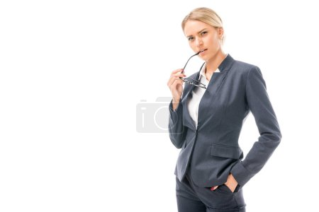 confident young businesswoman looking at camera with thoughtful expression isolated on white