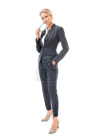 Photo for Serious young businesswoman looking at camera with thoughtful expression isolated on white - Royalty Free Image