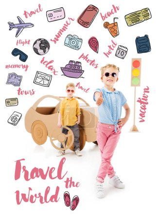 "stylish kid in sunglasses showing thumb up while boy standing near cardboard car and traffic lights, with trip icons and ""travel the world"" lettering"