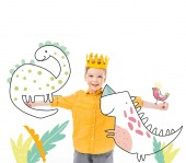 happy boy in yellow crown with imaginary dinosaurs on outstretched hands isolated on white