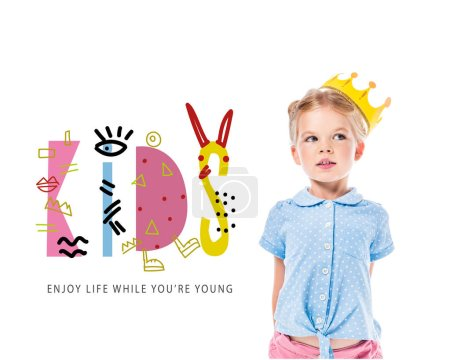 """adorable pensive kid in yellow crown, isolated on white with """"kids - enjoy life while you are young"""" inspiration"""