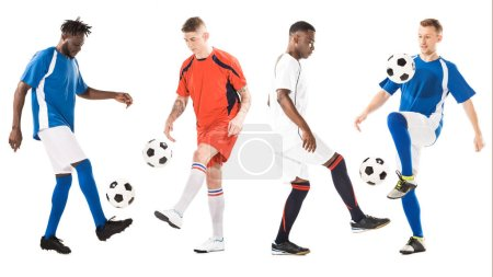 full length view of young multiethnic soccer players training with balls isolated on white