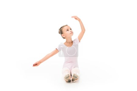 adorable little ballerina practicing isolated on white background