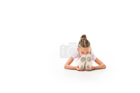 focused child stretching isolated on white background