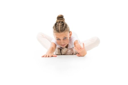 kid practicing gymnastics exercises isolated on white background