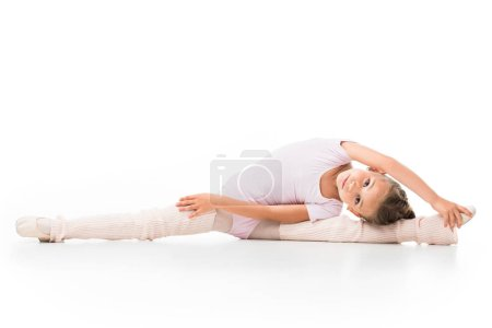 Photo for Little ballerina doing twine and stretching isolated on white background - Royalty Free Image