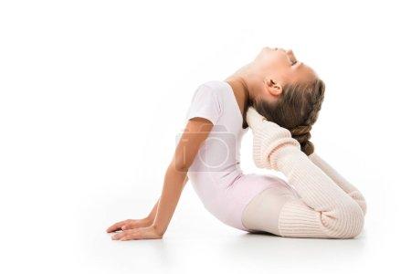 little ballerina doing gymnastics exercises isolated on white background