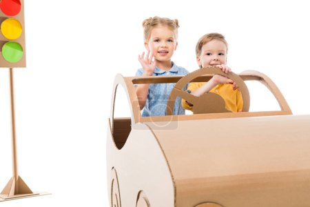 children driving cardboard car with traffic lights on background, isolated on white