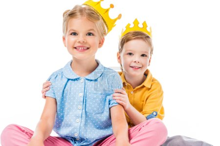 adorable children in yellow paper crowns, isolated on white