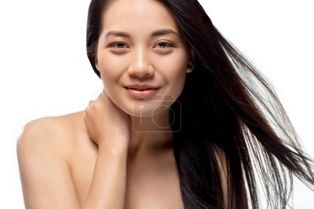 Photo for Portrait of smiling asian model with strong and healthy hair looking at camera isolated on white - Royalty Free Image