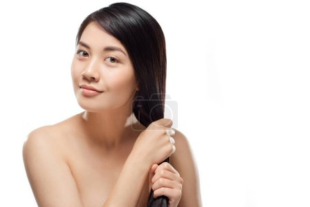 portrait of beautiful smiling asian woman with healthy dark hair isolated on white