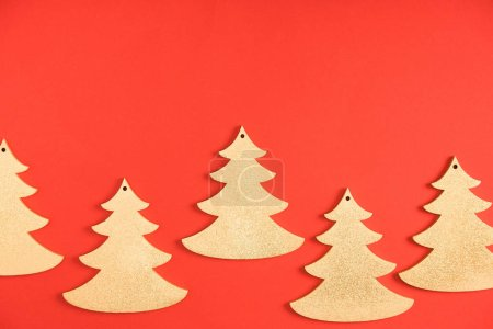 close-up view of decorative fir trees on red background