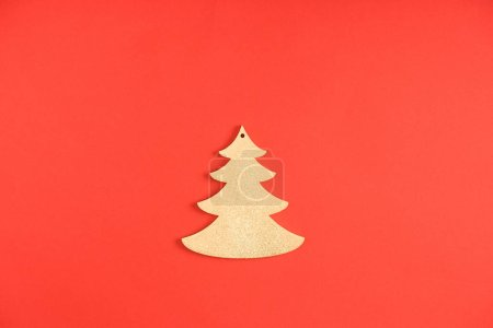 close-up view of decorative fir tree symbol on red background