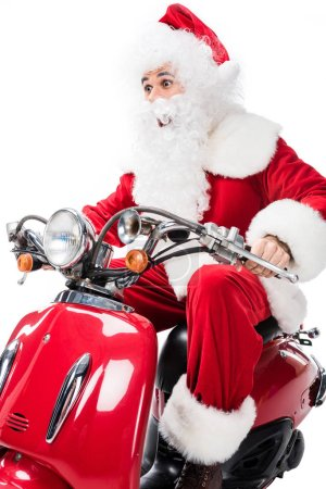 surprised santa claus in costume riding on scooter isolated on white background