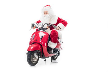 serious santa claus in costume riding on scooter isolated on white background