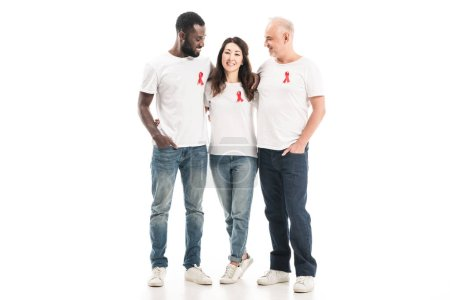 multiethnic group of people in blank white t-shirts with aids awareness red ribbons embracing and looking at each other isolated on white