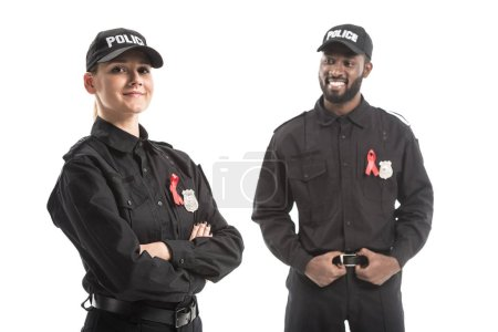 smiling police officers with aids awareness red ribbons isolated on white